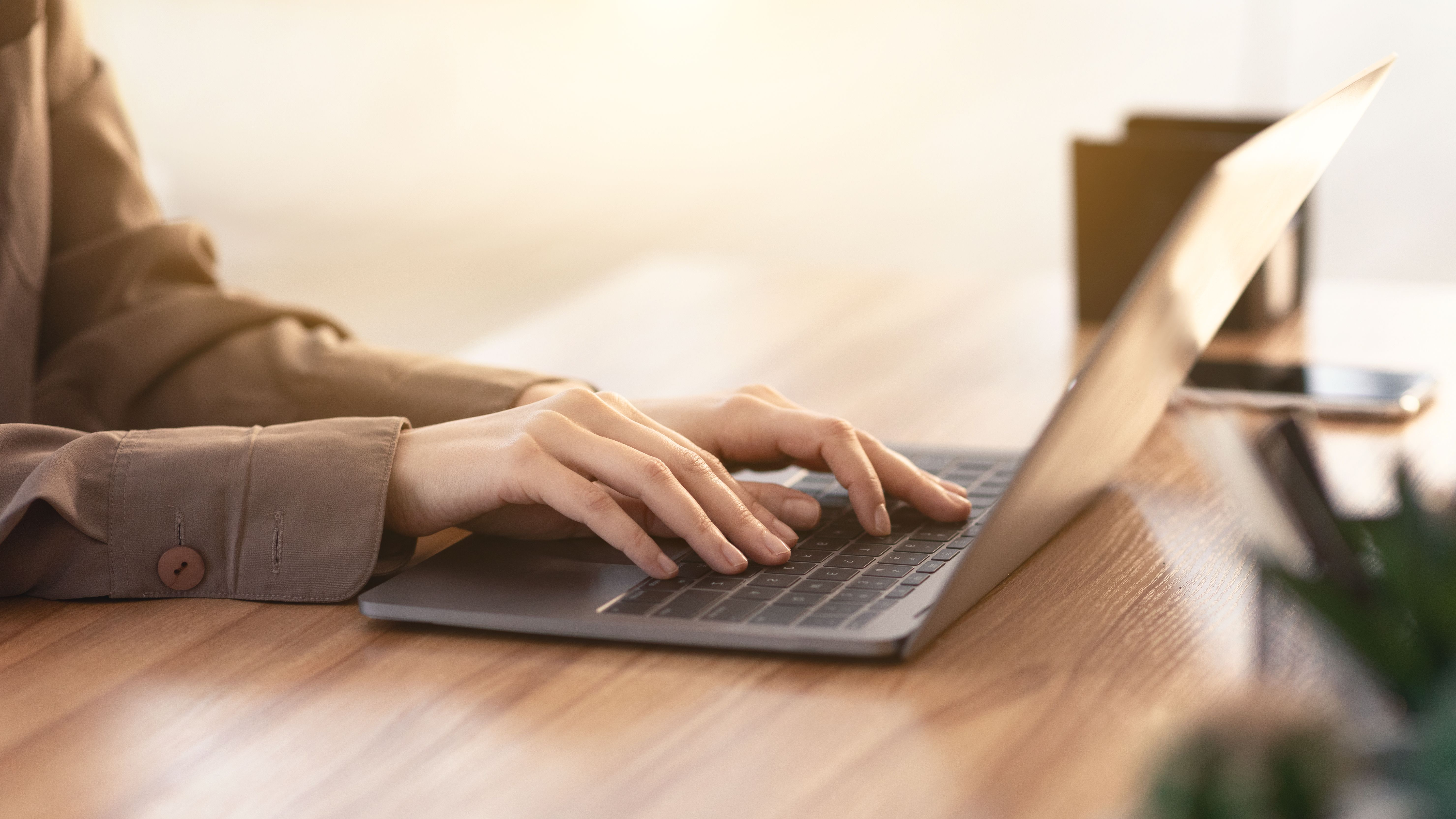 Cropped image of caucasian girl working on laptop
